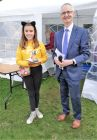 Grace Mooney,  winner in age 9 -11 group receiving prise from Gordon Moulds